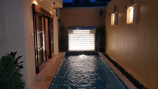 Enjoy a poolside drink after sunset